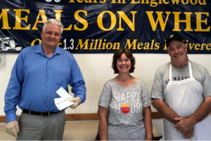 David Jones presents donations on behalf Englewood Democratic Club to Meals on Wheels